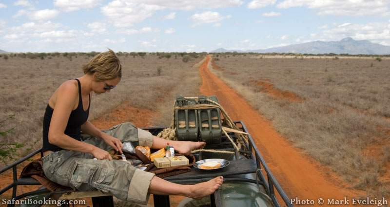 In a Kenyan national park it can be a good idea to eat lunch safely out of harm's way. Picture by Mark Eveleigh