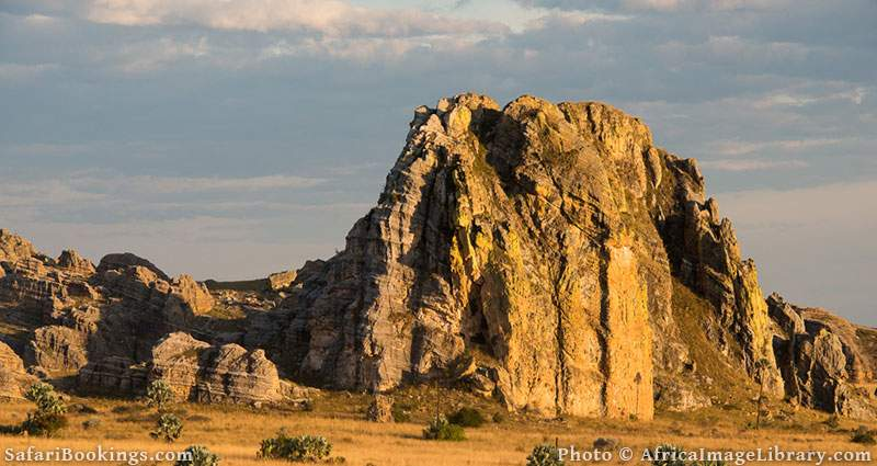 Sandstone formations jutting out from grassland at Isalo National Park, Madagascar