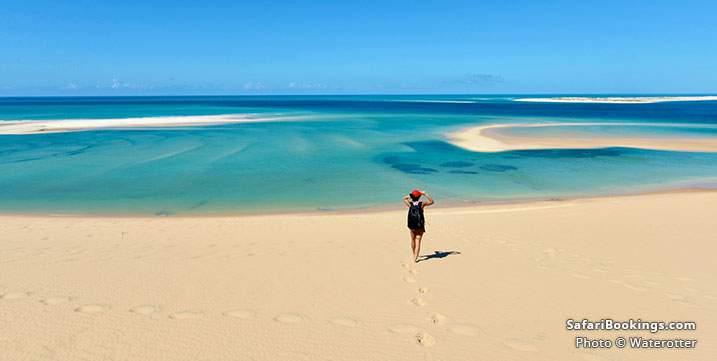 Tourist walking on an isolated beach