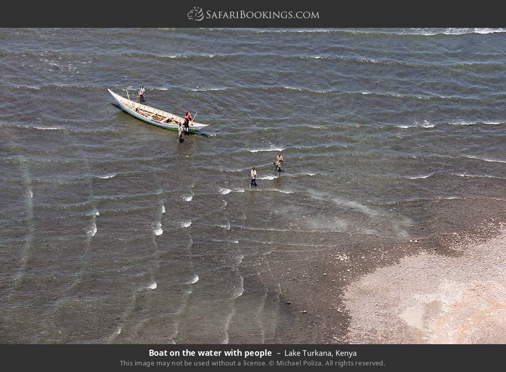 Boat on the water with people in Lake Turkana, Kenya