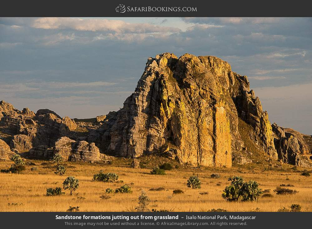 Sandstone formations jutting out from grassland in Isalo National Park, Madagascar