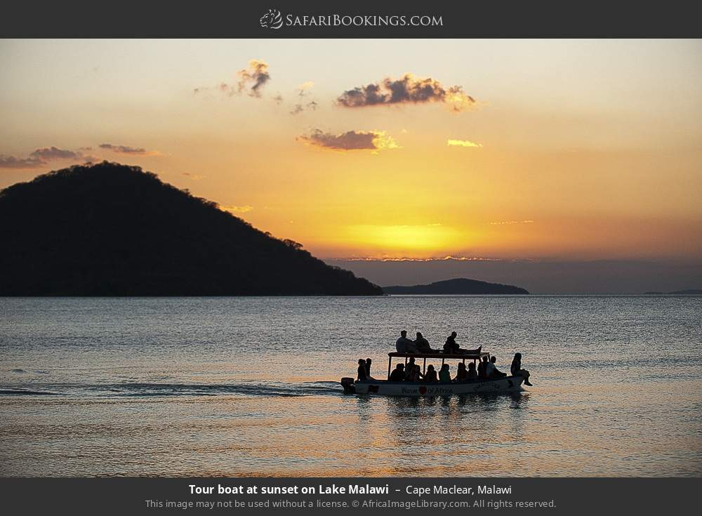 Tourist boat at sunset on Lake Malawi in Cape Maclear, Malawi