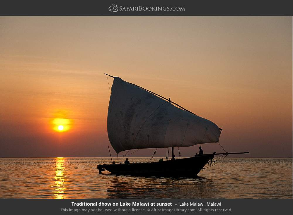 Traditional dhow on Lake Malawi at sunset in Lake Malawi, Malawi