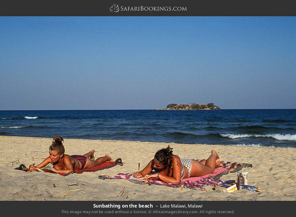 Sunbathing on the beach in Lake Malawi, Malawi
