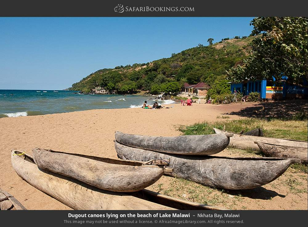 Dugout canoes lying on the beach of Lake Malawi in Nkhata Bay, Malawi