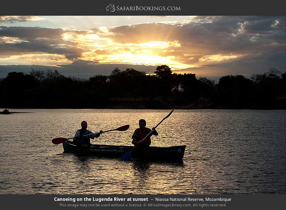 Canoeing on the Lugenda river at sunset in Niassa National Reserve, Mozambique