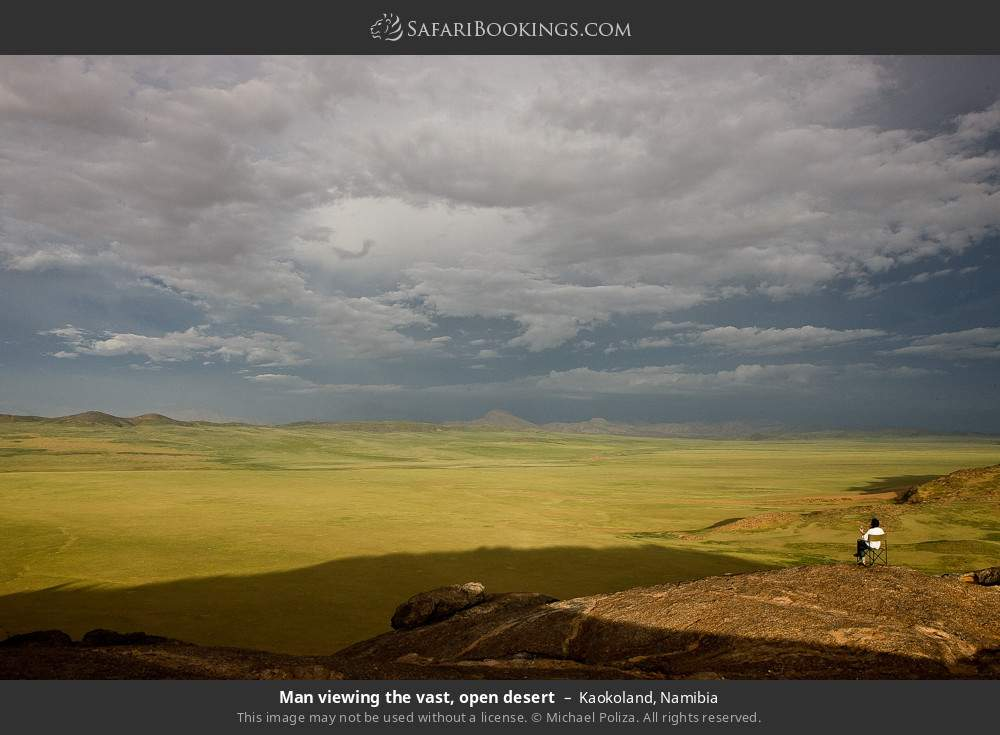 Man viewing the vast, open desert in Kaokoland, Namibia