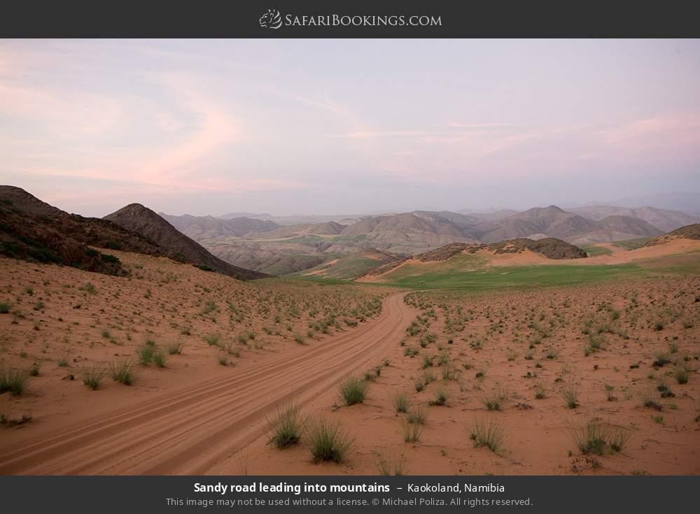 Sandy road leading into mountains in Kaokoland, Namibia