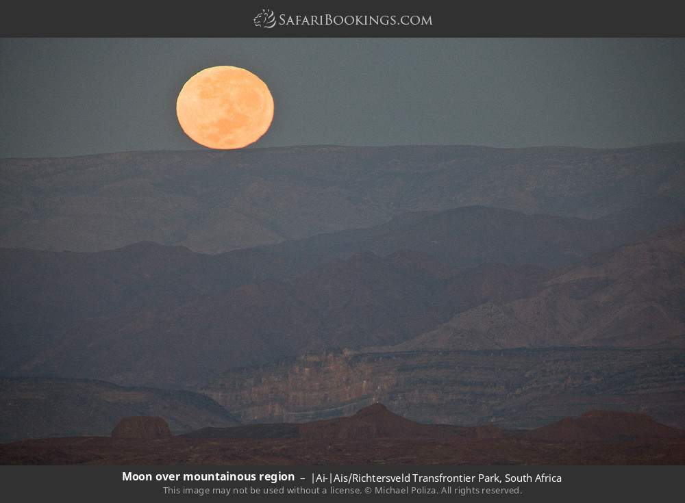 Moon over mountainous region in |Ai-|Ais Richtersveld Transfrontier Park, South Africa