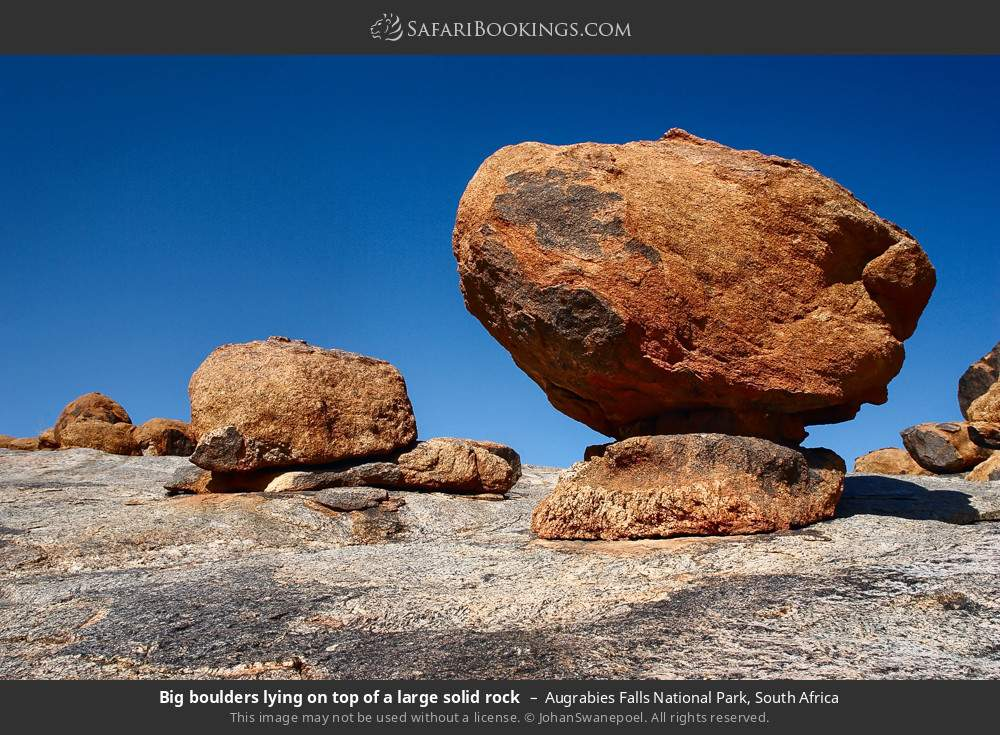 Big boulders lying on top of a large solid rock in Augrabies Falls National Park, South Africa