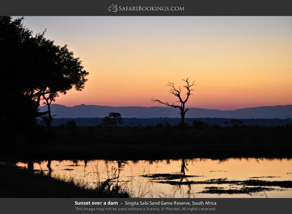 Sunset over a dam in Singita Sabi Sand Game Reserve, South Africa