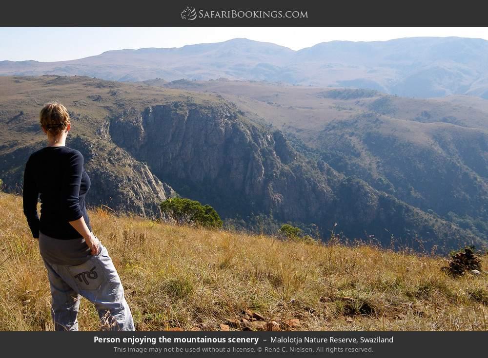 Tourist enjoying the mountainous scenery in Malolotja Nature Reserve, Swaziland