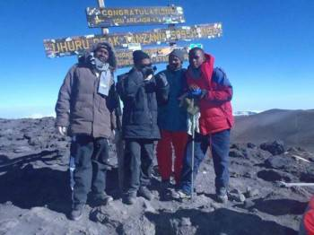 Alpha Tours team at Uhuru Peak - Mt. Kilimanjaro