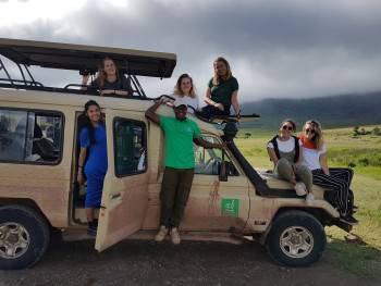 Director & Guide Freddy with clients in Ngorongoro