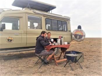 Clients having picnic breakfast in Serengeti