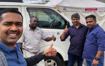 Driver-guide Joseph gets a thumbs up after a tour
