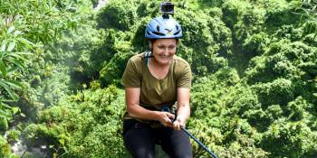 Our director abseiling 100m Sipi Falls, Uganda