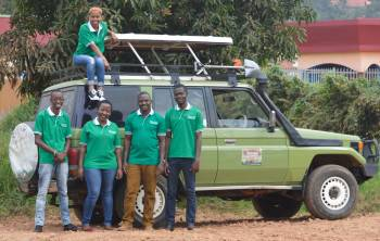 Five staff members and Safari Land cruiser