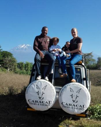 Ben and Marion with their family with Kilimanjaro