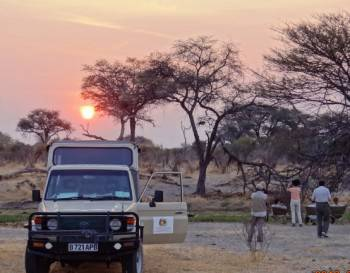 watching sunset after an exciting game drive